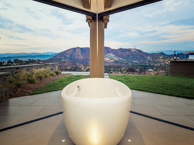 Shell shocked: The master bath of this Hollywood Hills hideaway features an eggshell tub and panoramic, 360-degree views by which to bathe.
